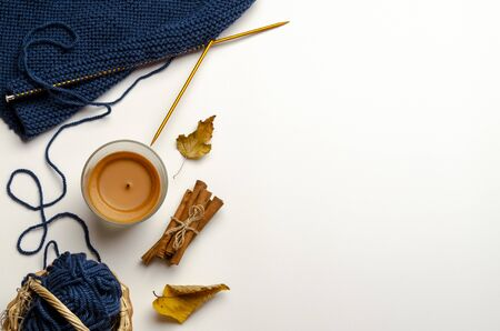 Autumn composition. candle cinnamon flat lay, top
