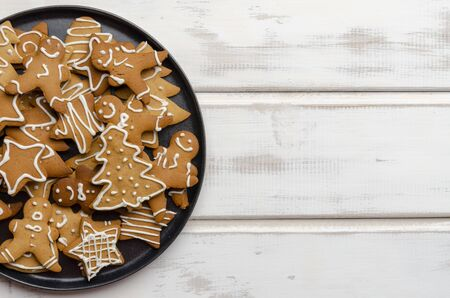 gingerbread christmas cookies on white wooden