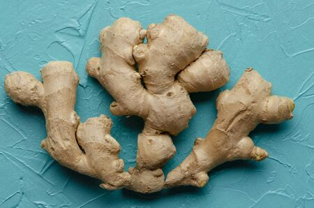 fresh ginger root on a color background