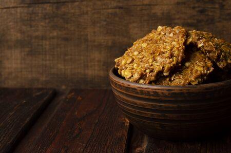 Pumpkin vegan oatmeal cookies with nuts on wooden