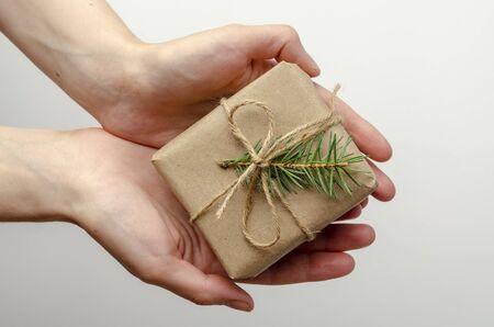 Christmas gifts holding by woman on white Фото со стока