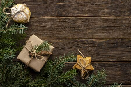 Christmas gifts with fir tree branches on wooden background Фото со стока