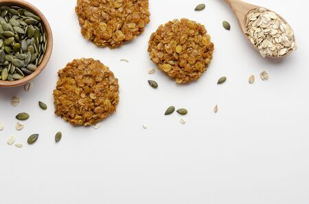 Pumpkin vegan oatmeal cookies with nuts on white