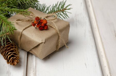 Christmas gifts with fir tree branches on white