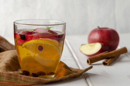 Spiced apple mocktail with mint and cinnamon. wooedn Stock Photo