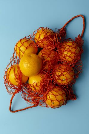 Mesh bag of fresh oranges healthy citrus fruits from