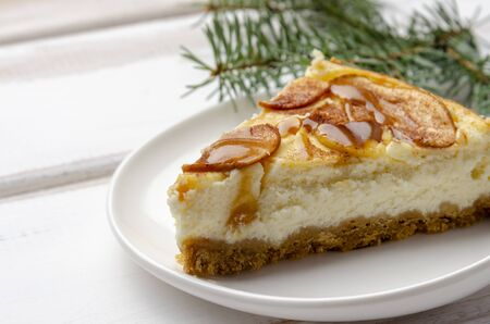 Christmas holiday cheesecake with apples. On wooden table with