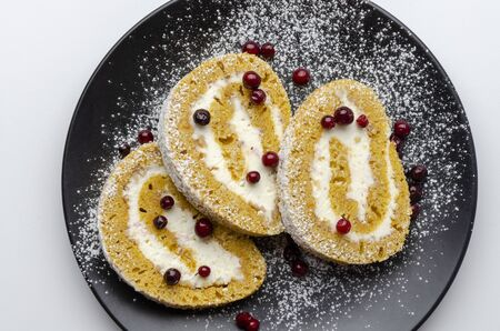 Pumpkin Roll with powdered sugar with walnuts pumpkin seeds