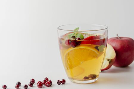 Spiced apple mocktail with mint and cinnamon. White
