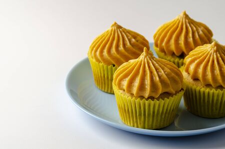 Pumpkin cupcakes with pumpkin-caramel cream Isolated on a White