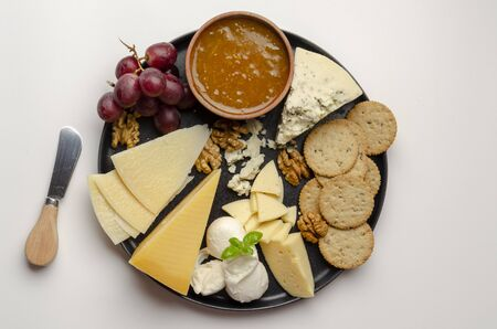 cheese plate on the white background with jam nuts Stock fotó