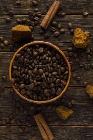 Mushroom Chaga Coffee mushrooms and coffee beans on dark