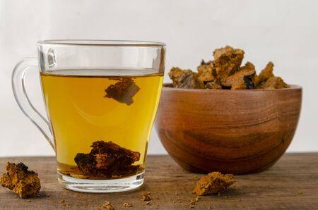Chaga mushroom tea. medicinal drink with pieces of