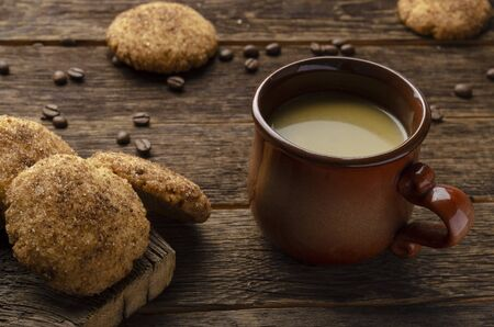 Bulletproof coffee with butter, recipe for ketogenic diet on a wooden