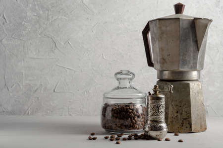 Old Coffee maker on a grey background