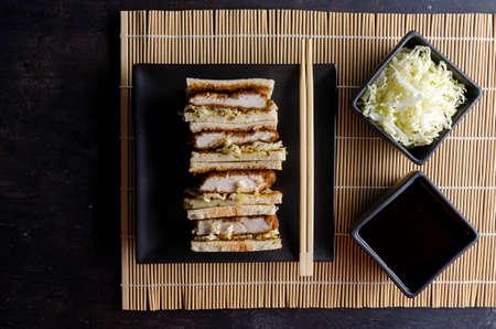 Katsu sandos japanese sandwich with chicken or pork chop, cabbage and tonkatsu sauce.