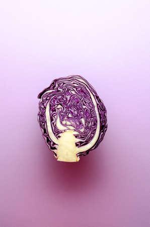 Violet cabbage on violet background. Minimalism photo.