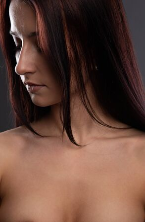 glamorous portrait of a pretty brunette covering her naked body with her hands. Close-up portrait of a charming girl Banque d'images