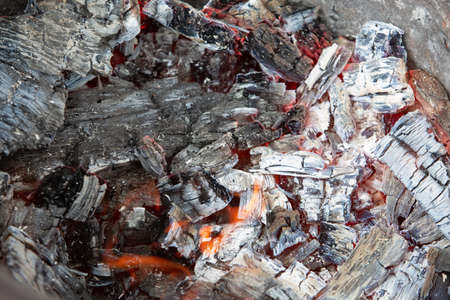 bright burning charcoal prepared for frying delicious barbecue, close-up photo. Archivio Fotografico