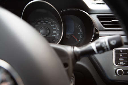 close-up of the steering wheel and instrument panel of the car