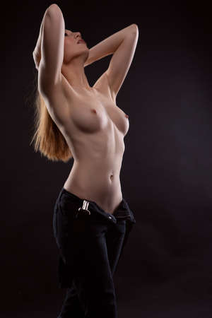 Sexy long-haired young woman with beautiful and slim body,