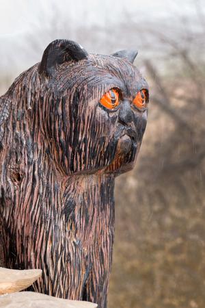 Figure wooden black cat cat close up.