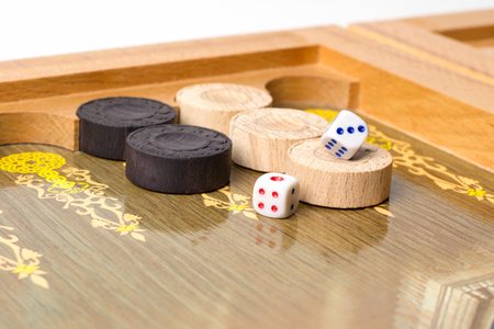 Board game backgammon. Chips, dice, playing field.
