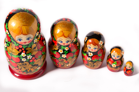 Russian folk toy. Matryoshka doll on white background.