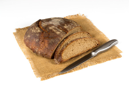 Grey knife-cut bread on white background Imagens