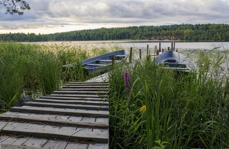 Old boat dock on a lake on a cloudy morning on a lake