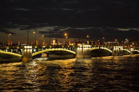 Exchange bridge with evening lighting. Night walks in St. Petersburg.