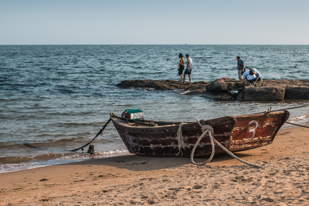 yellow boats: Old fishing boats on the bank of the Yellow Sea in China Stock Photo