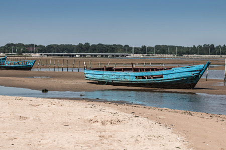 yellow boats: Old wooden boats on the bank of the Yellow Sea in China