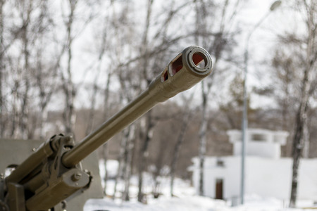 artillery shell: Trunk of a fighting gun in city park Stock Photo