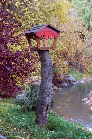 feeders: Wooden birds feeders in park for rest