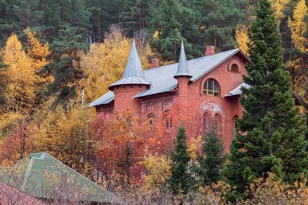 belokurikha: The stone house in the autumn wood in Belokurikha