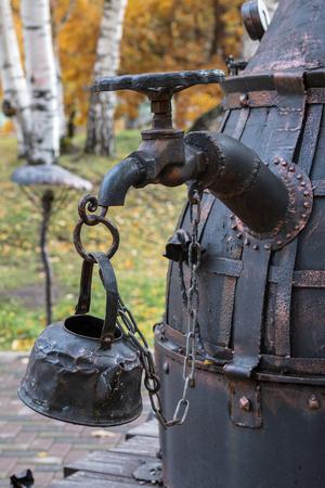 moonshine: Metal sculpture of the moonshine still in city park