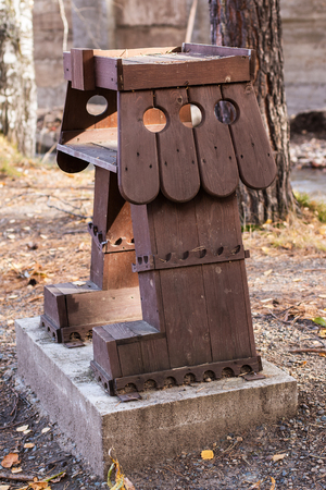 fall protection: Wooden birds feeders in park for rest