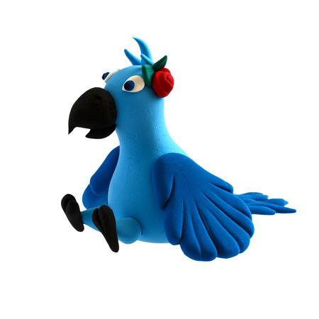 Figure of a parrot from plasticine on a white background Stock Photo