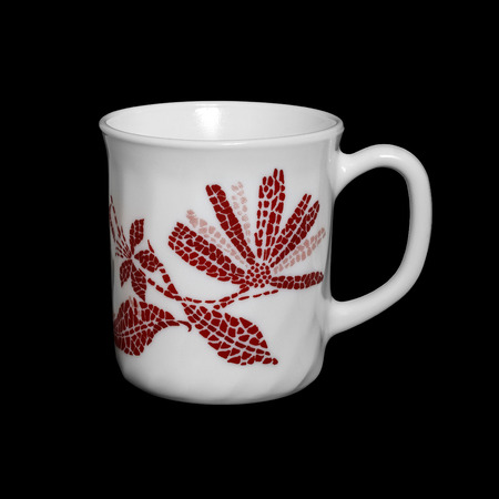 porcelain flower: White mug from porcelain with a flower on a black background Stock Photo