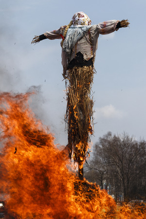 effigy: Effigy from straw on a city fire Stock Photo