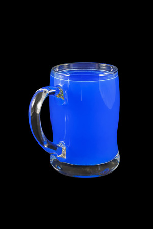 wares: Glass mug with water on a black background Stock Photo