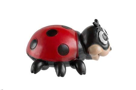 god's cow: Childrens toy from rubber on a white background