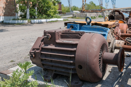 faulty: Old faulty electric motors in a warehouse under the open sky