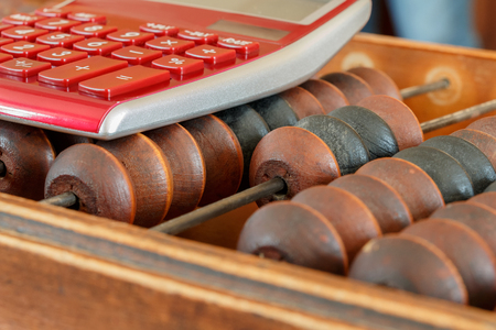 scores: Old wooden scores and the modern calculator at office Stock Photo
