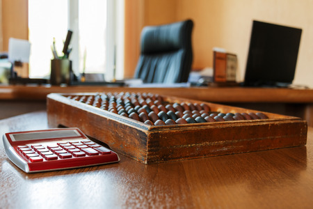 scores: Old wooden scores and the modern calculator in the heads office