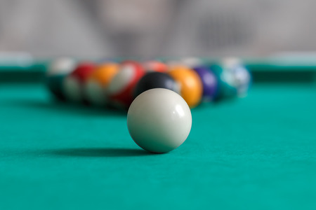 Childrens billiard balls on a game table Stock Photo