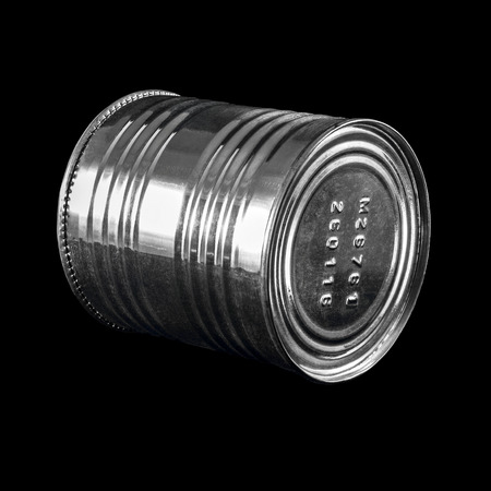 wares: Tin can for condensed milk on a black background