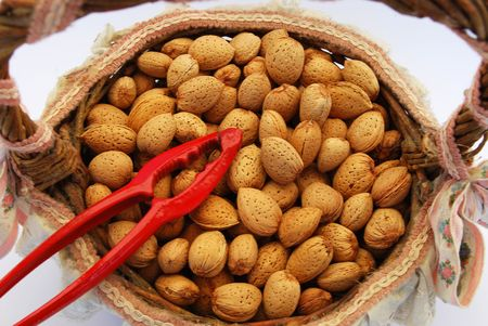 Almonds in a basket with nutcracker photo