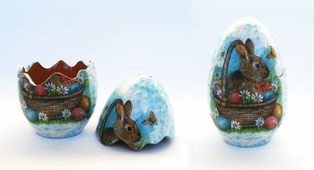An Easter clay egg that can be opened with a rabbit decoupage photo